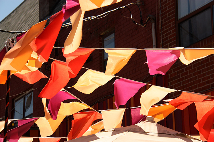 Toronto Photos :: Kensington market :: Colorful flags on Kensington Market